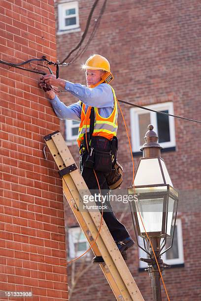 Cable lineman using butt set phone to activate cable connection