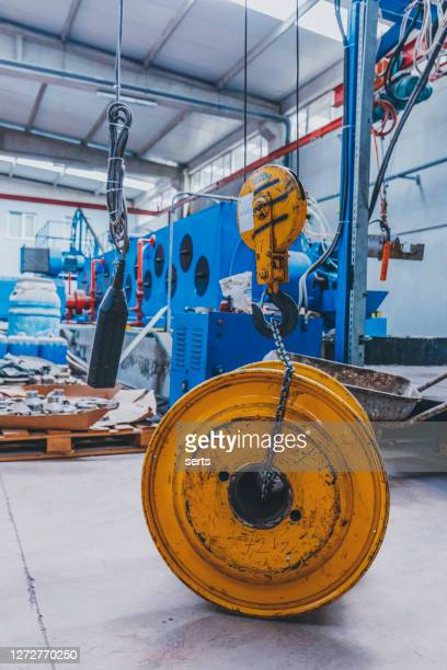 cable manufacturing machines and crane in steel industry - hoisting stock pictures, royalty-free photos & images