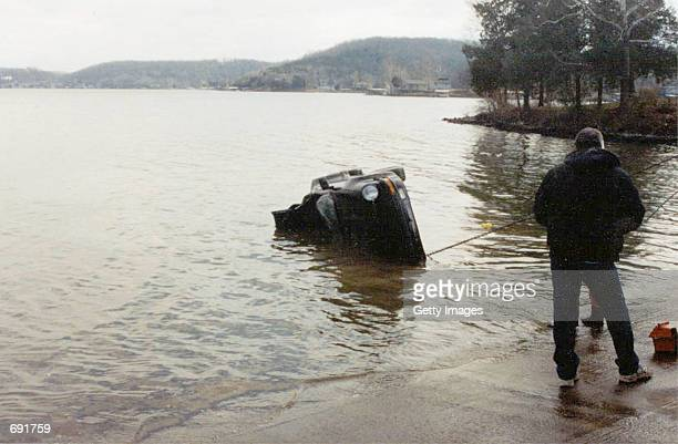 A cable pulls Actor Nicolas Cages 1989 Porsche Sportster January 16 2002 from the Lake of the Ozarks MO The $100000 collectors item was in transport...