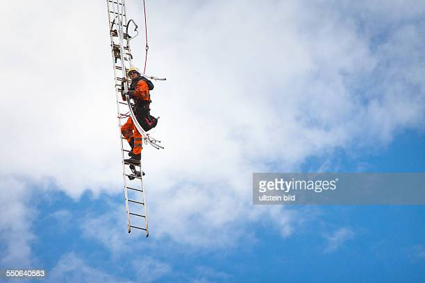 Cable rigger at work on a newly built transmission tower that is run by transmission system operator 50Hertz