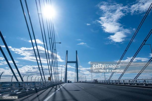 cable stayed bridge over port of yokohama in japan - 神奈川県 ストックフォトと画像