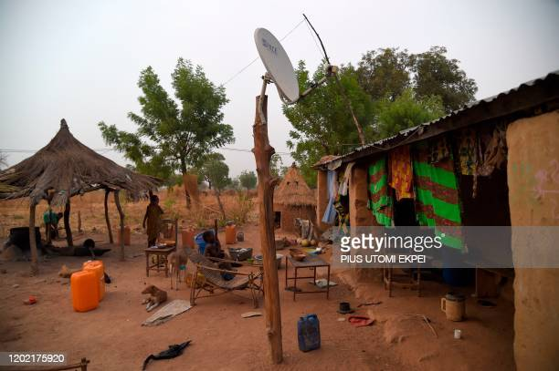 Cable TV dish mounted on a wood and powered by solar power installed in the Takpapieni village in Oti province, northern Togo, on February 14, 2020....