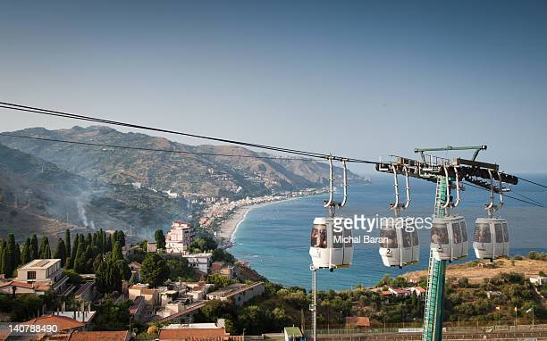cablecars of taormina - taormina stock pictures, royalty-free photos & images