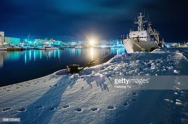 Cabled vessel in Otaru Harbour covered by deep snow, Japan
