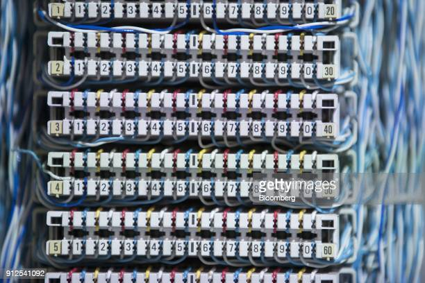 Cables and insulation displacement contact blocks sit inside a very high bit rate digital subscriber line telecoms cabinet as Royal KPN NV hold a...