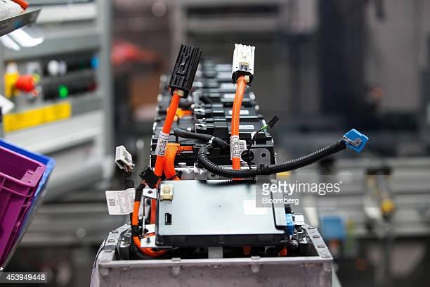 Cables and lithiumion battery components sit on the production line at the Bayerische Motoren Werke AG automobile manufacturing plant in Dingolfing...