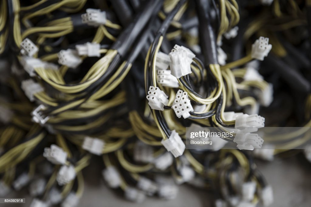 Cables for bitcoin mining machines sit on the floor at a mining facility operated by Bitmain Technologies Ltd. in Ordos, Inner Mongolia, China, on Friday, Aug. 11, 2017. Bitmainis one of the leading producers of bitcoin-mining equipment and also runs Antpool, a processing pool that combines individual miners from China and other countries, in addition to operating one of the largest digital currency mines in the world. Photographer: Qilai Shen/Bloomberg via Getty Images