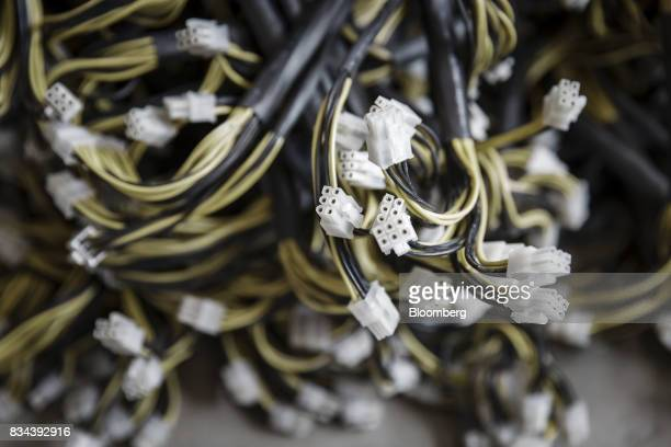 Cables for bitcoin mining machines sit on the floor at a mining facility operated by Bitmain Technologies Ltd in Ordos Inner Mongolia China on Friday...