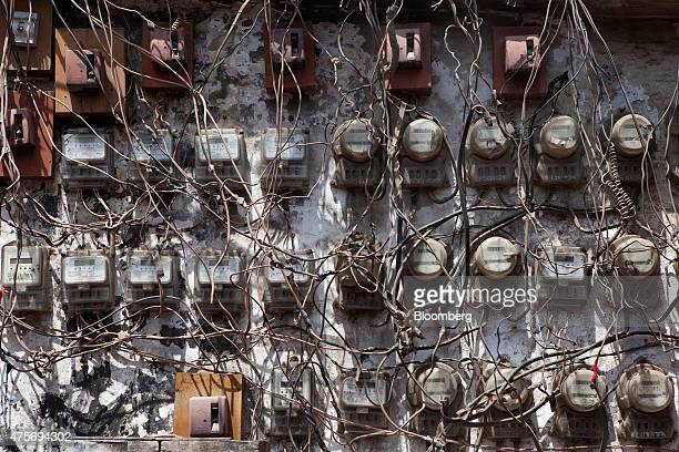 Cables hang from electricity meters at a market in Karachi Pakistan on Thursday May 28 2015 Pakistan's budget is scheduled to be presented on June 5...