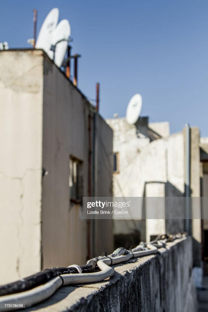 Cables On Retaining Wall Against Buildings : Photo