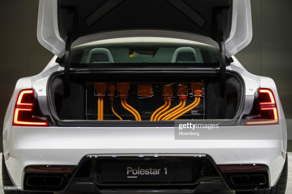 Cables sit in the trunk of a Polestar 1 electric automobile, manufactured by Volvo, on the opening day of the 88th Geneva International Motor Show in Geneva, Switzerland, on Tuesday, March 6, 2018. The show opens to the public on March 8, and will showcase the latest models from the world's top automakers. Photographer: Stefan Wermuth/Bloomberg via Getty Images