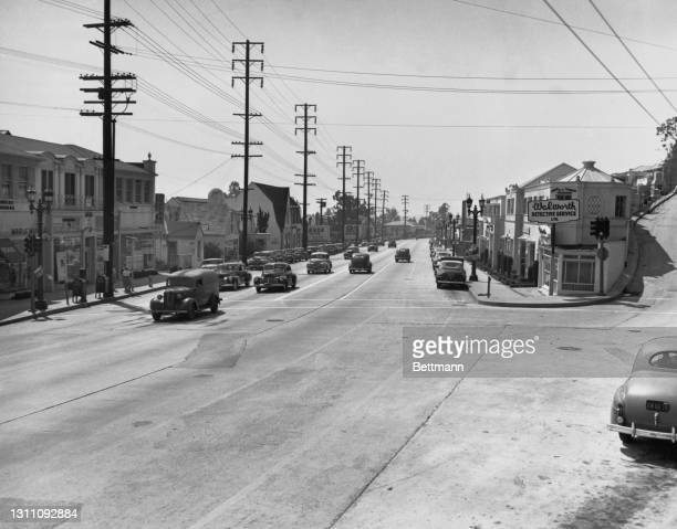 Cables suspended overhead from utility poles while below motorists make their way long Sunset Strip, a stretch of Sunset Boulevard that passes...