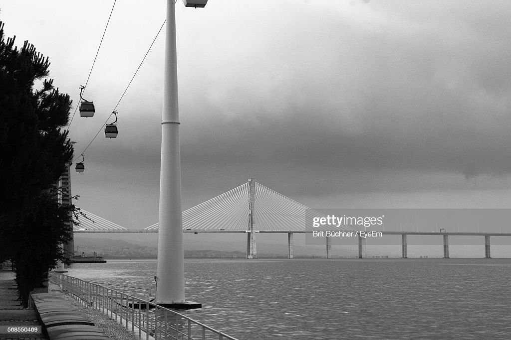 Cable-Stayed Bridge Over River Against Cloudy Sky : Stock Photo