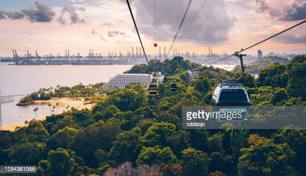 cableway trip in sentosa island, singapore - singapore stock pictures, royalty-free photos & images