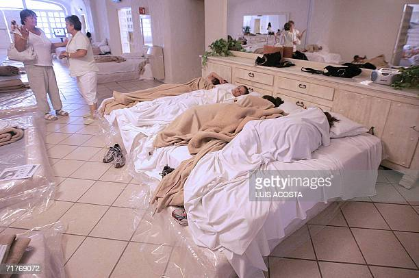 US tourists wait in a shelter for Hurricane John to hit the shores 01 September 2006 in Cabo San Lucas Baja California Mexico Hurricane John neared...