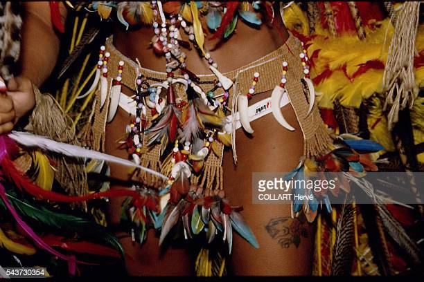 Cabocle sporting forest dress jaguar claws toucan parrot and macaw feathers plant fibre loincloth various seeds etc