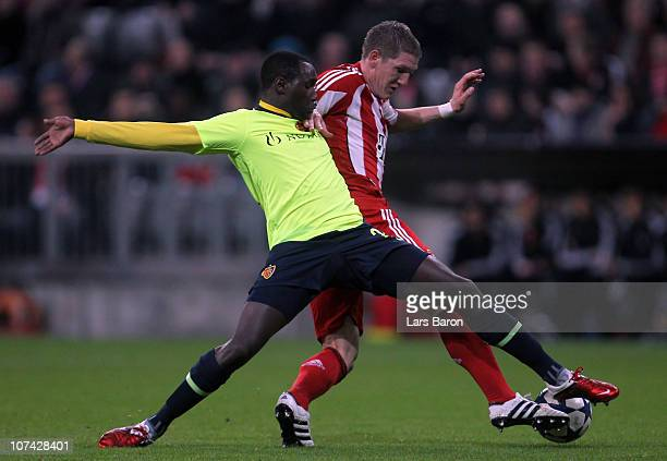 Cabral of Basel challenges Bastian Schweinsteiger of Muenchen during the UEFA Champions League group E match between FC Bayern Muenchen and FC Basel...