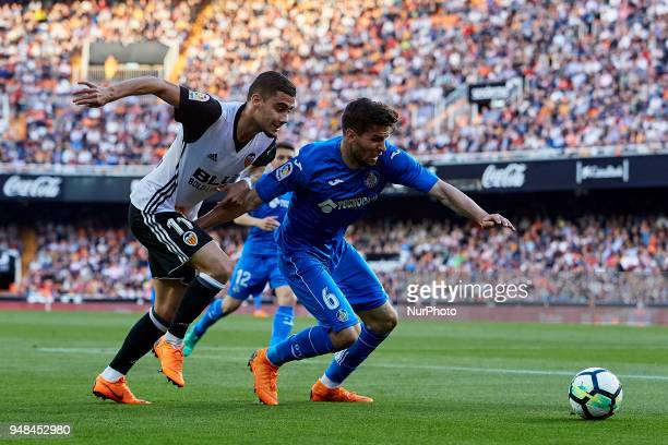Cabrera of Getafe CF competes for the ball with Andreas Pereira of Valencia CF during the La Liga game between Valencia CF and Getafe CF at Mestalla...
