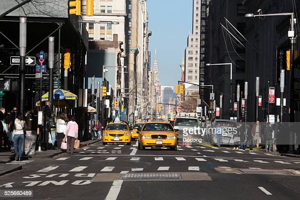 Cabs and pedestrians on Broadway