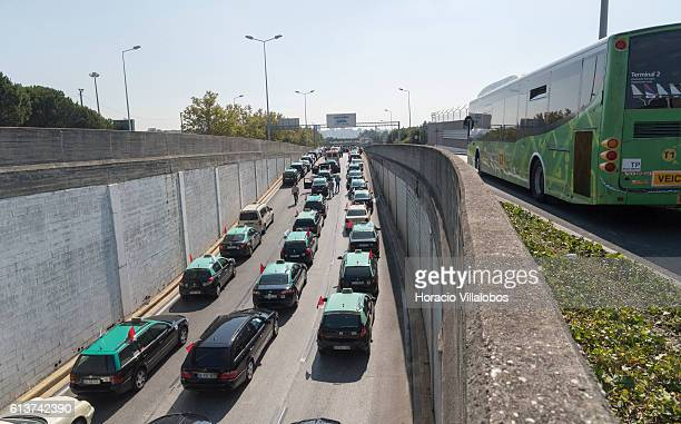 Cabs block the airport exit during taxi drivers blockade of 'Rotunda do Relogio' outside the International Airport after a brief scuffle with the...