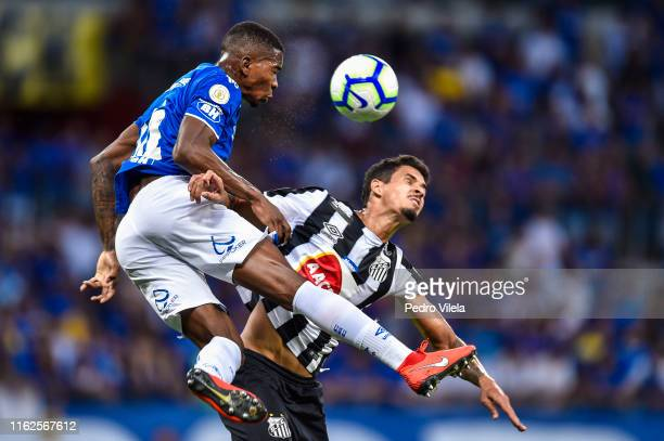 Caca of Cruzeiro and Lucas Verissimo of Santos battle for the ball during a match between Cruzeiro and Santos as part of Brasileirao Series A 2019 at...