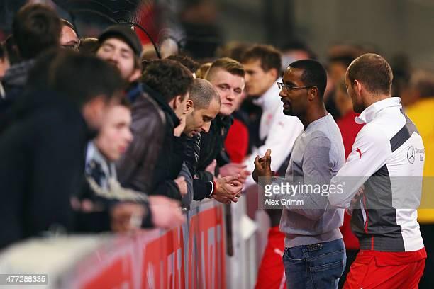 Cacau and Konstantin Rausch of Stuttgart discuss with the fans after the Bundesliga match between VfB Stuttgart and Eintracht Braunschweig at...