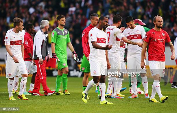 Cacau and team mates of Stuttgart react after the Bundesliga match between VfB Stuttgart and Borussia Dortmund at MercedesBenz Arena on March 29 2014...