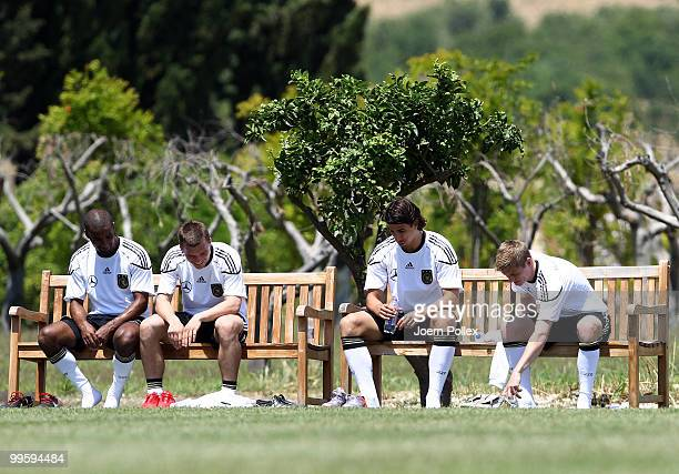 Cacau Lukas Podolski Sami Khedira and Toni Kroos of Germany are pictured after the German National Team training session at Verdura Golf and Spa...