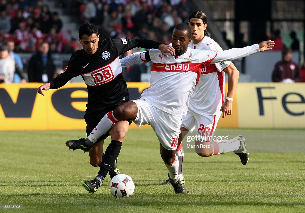Cacau (R) of Stuttgart and Cicero (L) of Berlin battle for the ball during the Bundesliga match between VfB Stuttgart and Hertha BSC Berlin at the Mercedes-Benz Arena on March 21, 2009 in Stuttgart, Germany.