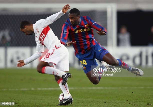 Cacau of Stuttgart battles for the ball with Yaya Toure of Barcelona during the UEFA Champions League round of sixteen first leg match between VfB...