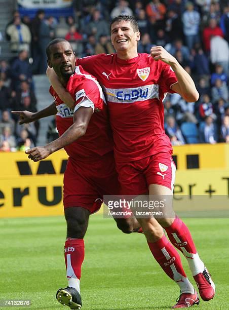 Cacau of Stuttgart celebrates scoring the 5th goal with his team mate Mario Gomez during the Bundesliga match between VFL Bochum and VFB Stuttgart at...