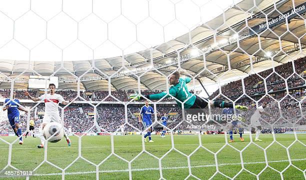 Cacau of Stuttgart scores a goal past Ralf Faehrmann of Schalke during the Bundesliga match between VfB Stuttgart and FC Schalke 04 at Mercedes-Benz...