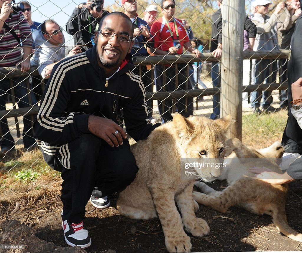 Cacau of the German National Team strokes a lion cup during a visit at the Lion Park on June 25, 2010 in Lanseria, South Africa.