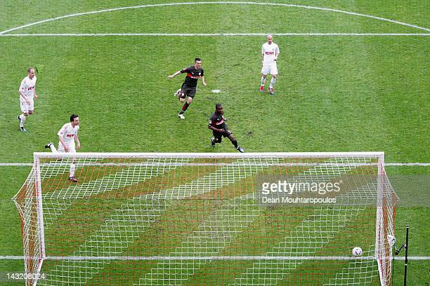 Cacau of VfB watches his shot go in off the post to score his teams only goal during the Bundesliga match between 1 FC Koeln and VfB Suttgart at...