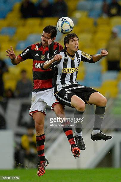 Caceres of Flamengo battles for the ball with Zeballos of Botafogo during the match between Flamengo and Botafogo as part of Brasileirao Series A...