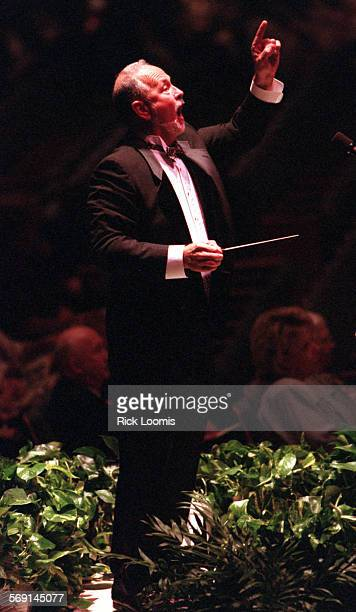 Chorale.conduct.0420.RL–Garden Grove–William Hall leads the Master Chorale during a performance Sunday evening at the Crystal Cathedral in Garden...