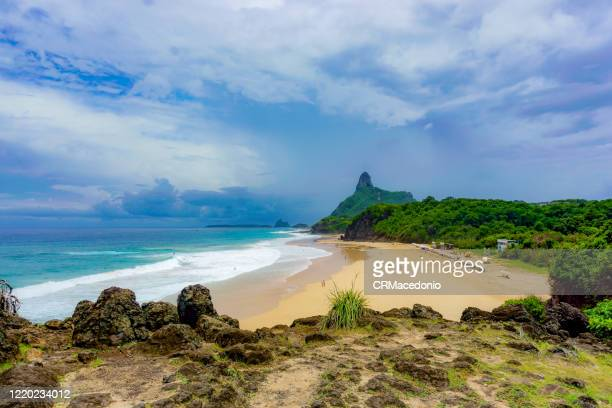 cacimba beach, one of the longest beaches in fernando de noronha, is a must go in the island, especially for surfers. - crmacedonio stock-fotos und bilder