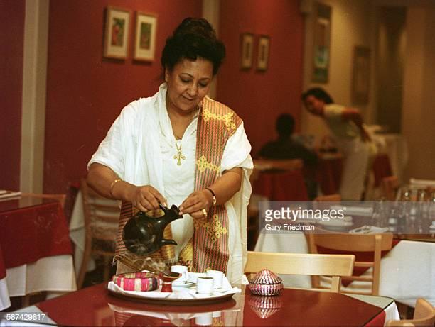 CACounter20129GF8 Ellene Mishesha partakes in the Ethiopian traditional coffee ceremony at Ibex Ethiopian restaurant in Pasadena