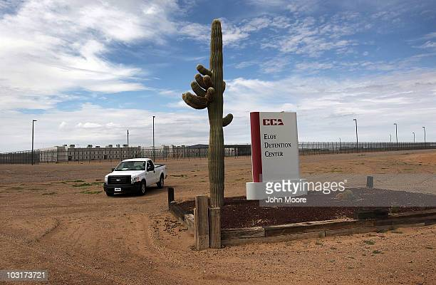 Cactus and sign mark the entrance to the Eloy Detention Facility for illegal immigrants on July 30, 2010 in Eloy, Arizona. Most immigrants at the...