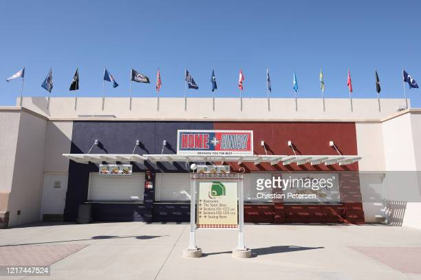 Cactus League team flags are flown inside of the Texas Rangers and Kansas City Royals spring training facility Surprise Stadium on April 07 2020 in...