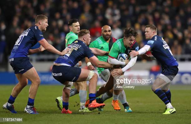 Cadan Murley of Harlequins is tackled by Chris Ashton and JeanLuc du Preez of Sale Sharks during the Gallagher Premiership Rugby match between Sale...