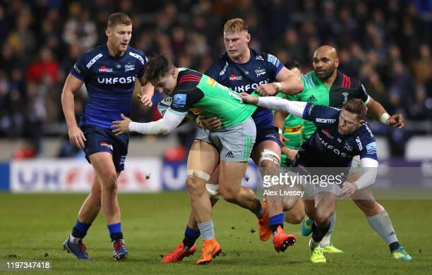 Cadan Murley of Harlequins is tackled by Chris Ashton of Sale Sharks during the Gallagher Premiership Rugby match between Sale Sharks and Harlequins...
