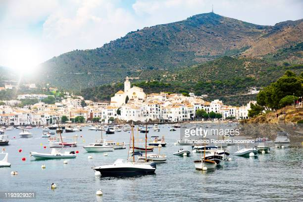 cadaques, gerona province, spain. sunny day with boat and coastline - cadaques stock pictures, royalty-free photos & images
