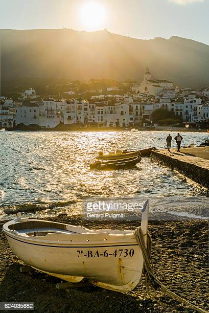 cadaqués in the costa brava (catalonia) under golden rays of sun in the evening on summertime - cadaques stock pictures, royalty-free photos & images