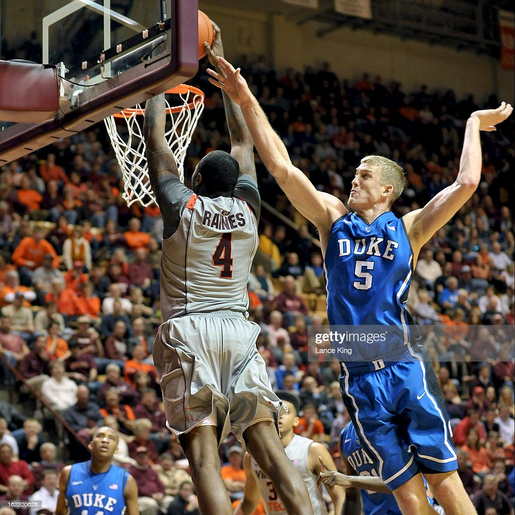 Cadarian Raines #4 of the Virginia Tech Hokies goes up for a dunk against Mason Plumlee #5 of the Duke Blue Devils at Cassell Coliseum on February 21, 2013 in Blacksburg, Virginia. Duke defeated Virginia Tech 88-56.