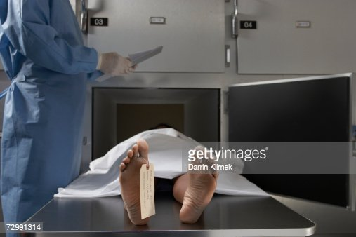 Cadaver On Autopsy Table Label Tied To Toe Closeup Stock