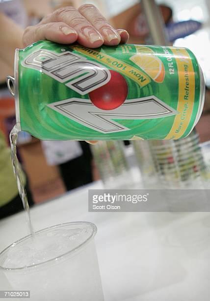 Cadbury Schweppes representative pours a sample of reformulated '100% Natural' 7Up soda at the National Restaurant Association's annual trade show...