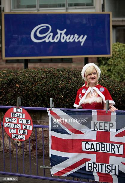 A Cadbury worker dressed up in a Santa Claus costume is pictured during a protest at the Cadbury factory in Birmingham central England on December 15...