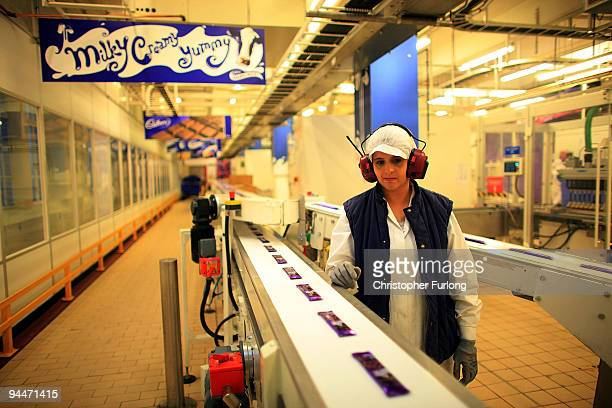 Cadbury's chocolate bars move down the production line at the Cadbury's Bournville production plant on December 15 2009 in Birmingham England The...