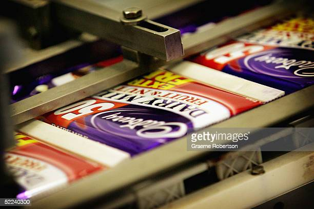 Cadbury's chocolate bars on the production line in the factory February 25 2005 in Birmingham England The company is celebrating 100 years of...